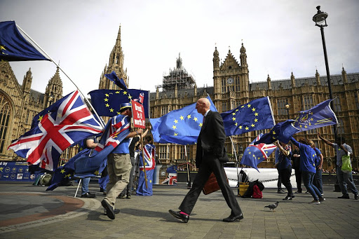 Anti-Brexit demonstrators wave flags outside the UK Houses of Parliament, in London, September 10 2018. Picture: REUTERS/HANNAH MCKAY