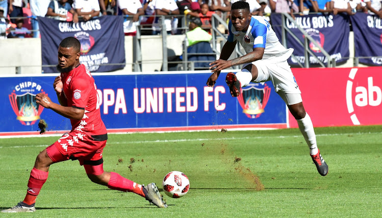 Chippa United's Zitha Macheke fires a shot past Highlands Park's Ricardo Williams in their Absa Premiership match at NMB Stadium on 17 March 2019