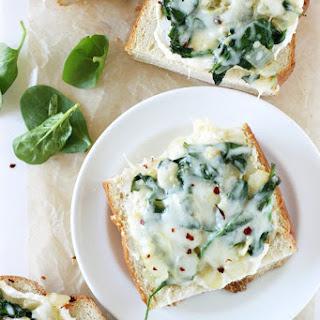 Spinach Artichoke French Bread Pizzas.