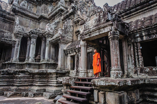 siem-reap.jpg - A monk looks out from an ancient compound at Angkor Wat, Siem Reap, Cambodia.