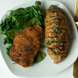 Seared Pork Chops with Hasselback Sweet Potatoes and Steamed Spinach with Olive Oil.