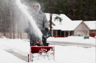 Photo: Richard Edmondson of Flagstaff uses his snow blower to clear the snow from in front of his house Tuesday morning. Photo by Sean Ryan, The Arizona Republic.