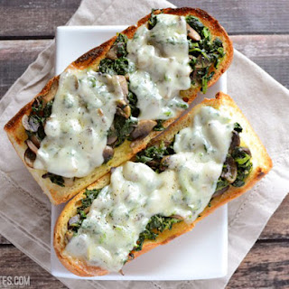 Mushroom Spinach and Swiss French Bread Pizzas.