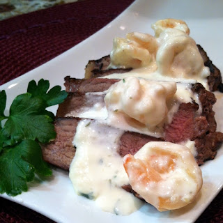 Sirloin Topped with Shrimp in Garlic Cream Sauce.