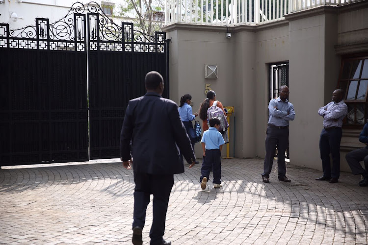 Private security at the compound initially refused to let the authorities in, but that they later relented.