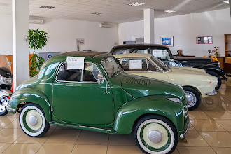 Photo: Vintage cars inside the car place.  Note the signs are in English only.