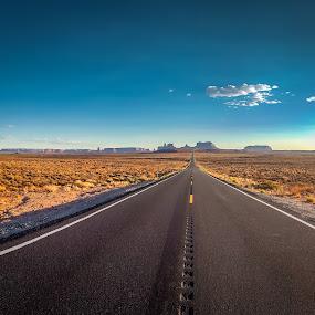 monument valley by Sunil Pawar - Transportation Roads ( long journey, navajo, mittens, arizona, nation, destination, monument, utah, tourist, horizon, international landmark, outdoors, road, street, valley, western, desert, nobody, over land, landscape )