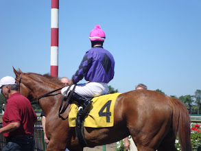 "Photo: The winner of the race named after The Kortney Rose Foundation, ""Breath of Fresh Air"" at our Day at the Races event 8/29/10. Notice the helmet and silk colors! How amazing! I won on this horse because I had to bet on it for the pink and purple!"