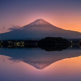 Mt. Fuji over Lake Kawaguchiko at sunset in Fujikawaguchiko, Japan. by Nuttawut Uttamaharach - Landscapes Mountains & Hills ( japan, kawaguchi, scenic, scene, red, beautiful, mountain, view, japanese, leaves, season, landmark, sky, sakura, natural, reflection, mt, mount, water, morning, momiji, light, background, autumn, lake, colorful, fog, sunrise, color, destination, scenery, sea, summer, fall, volcano, famous, nature, asia, koto, orange, outdoor, tokyo, foliage, outdoors, sunset, maple, evening, travel, fuji, landscape )