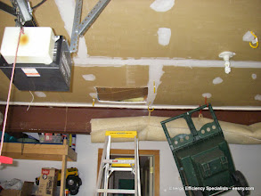 Photo: Access here.  Note joist bays open above garage ceiling leading straight into house from garage attic