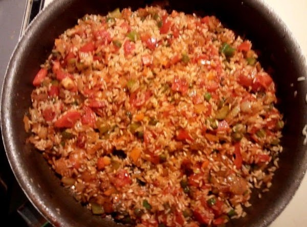 Slowly add your rice, mixing it well to incorporate it into the dish. ...