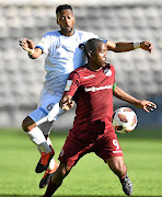 Lebohang Mokoena of Swallows  shields the ball from  Manti Mekoa of Cape Umoya United   at Athlone Stadium  in Cape Town. United won 1-0. / Ashley Vlotman/gallo images