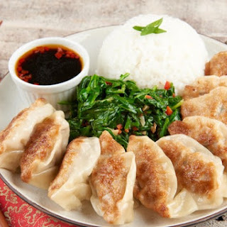 Dim Sum Pork Dumplings With Spicy Sesame Spinach and Rice