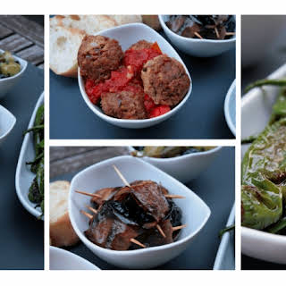 Three kinds of warm Tapas with olives.