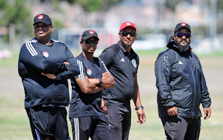 The Magic FC technical team from left to right: Assistant coach Zane Alexander, head coach David Kannemeyer, assistant Zane Ryklief and goalkeeper coach Shivaan Sayed look on during a training session at Royal Road Fields in Cape Town on February 12 2019.