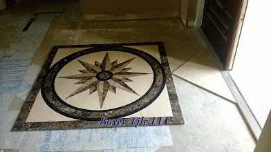 Photo: This custom inlay's position in this room will be the starting point for this installation. The other tile in this installation will be set on a diagonal, so the inlay's position has to be set to accommodate that layout.