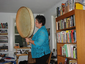 Photo: Carol playing the grandfather drum.
