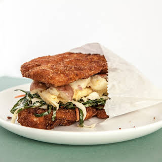 Fried Chicken and Waffle Sandwich with Potato Salad and Collard Slaw.