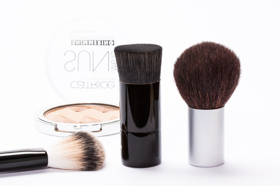 make up brushes on white surface