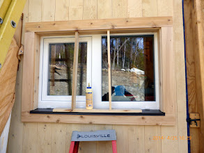 """Photo: As much EPS as possible hiding the frame; metal pan broken (""""braked""""?) on site; all local cedar; breahting room under the side pieces; Geocel where metal meets frame under weep holes; edge of metalwedged into place 'til the Orcon F sets up."""