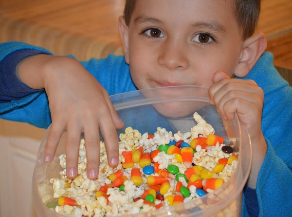 My youngest son Bobby, so excited for Happy Movie Night and a sweet and Salty treat !