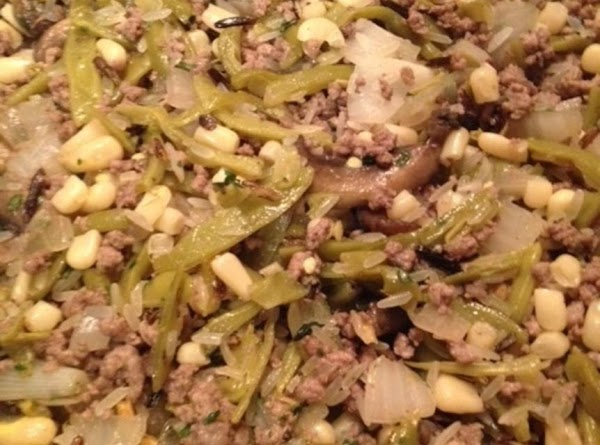 Add back in mushrooms and onion, corn, green beans, wild rice and seasoning packet....
