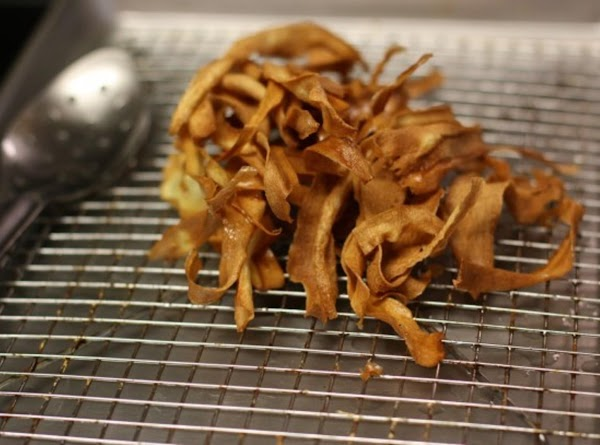 Fried Parsnip Ribbons:  Place a wire rack on a large, rimmed baking sheet and line...