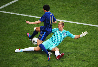 Photo: Joe Hart of England blocks Samir Nasri of France during the UEFA EURO 2012 group D match between France and England at Donbass Arena on June 11, 2012 in Donetsk, Ukraine.