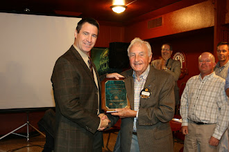 Photo: George Carscallen also received the Distinguished Fifty Year Member award from Society this past year and here he is presented with the official plaque.