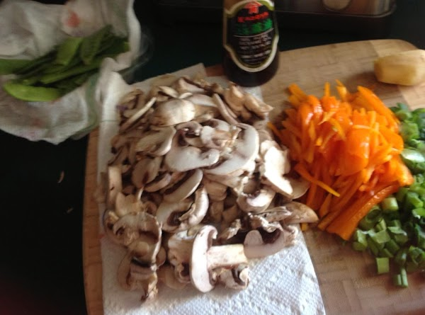 Slice the peppers in match sticks, dice the scallion, slice the mushrooms