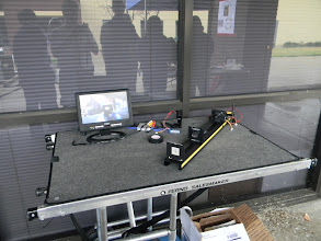 Photo: Demonstration (OptoBotics) of wireless video system focused on distant objects and the near target (through on board lens) at the same time.