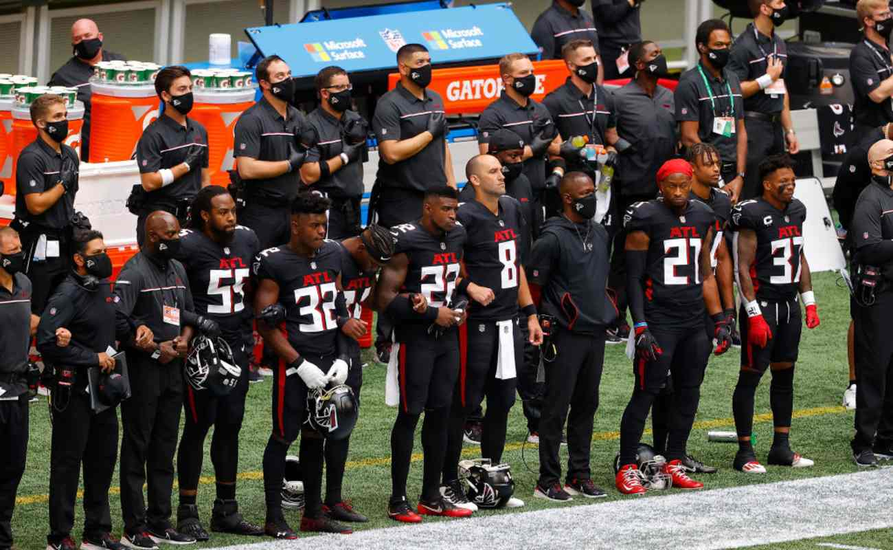 The Atlanta Falcons stand during the National Anthem
