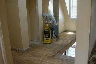 Photo: March 2006 - Month 31: Andrew sanding the third floor hall