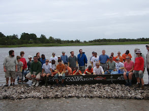 Photo: 2009 volunteers with CCA donated boat