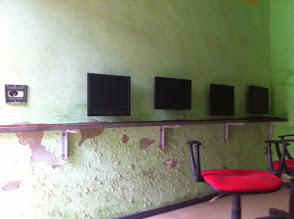 Photo: wall monitors connected to towers in the room behind the wall. Switching to a thin client setup so we can run everything on solar inverters instead for processing files to print or edit quickly.