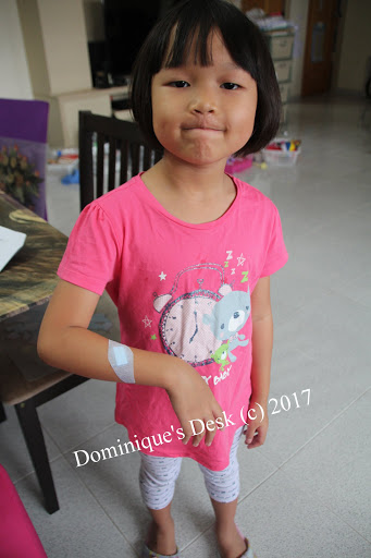 Tiger girl with a bandage on her hand