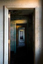 Photo: Doors between patient rooms in Building G, Mayview State Hospital.