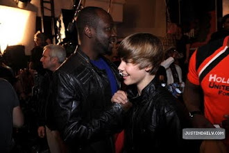 """Photo: HOLLYWOOD - FEBRUARY 01:  Singers Wyclef Jean (L) and Justin Bieber at the """"We Are The World 25 Years for Haiti"""" recording session held at Jim Henson Studios on February 1, 2010 in Hollywood, California.  (Photo by Kevin Mazur/WireImage)"""