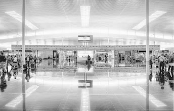 Photo: The Barcelona Airport  This is another reason I like to get to airports early.  Not only do I hate being rushed, but I like to take time to explore with my camera.  Well, I guess that only is in the case where the airport happens to be particularly beautiful, like the one here in Barcelona.  I always start out extremely rushed, because I picture security closing down on me from every angle.  So, my first shot is usually rushed and not perfectly centered.  Then, if the guards don't gang-tackle me like I'm streaking at Yankee Stadium, then I keep adjusting my position and the camera until things are more and more aligned and composed to my satisfaction.  This one was even a little bit tilted, but I fixed that bit with the crop tool later in Photoshop (as people saw).  from the blog at www.stuckincustoms.com
