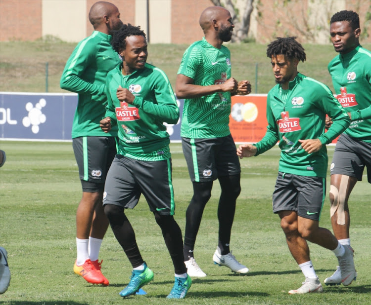Bafana Bafana Belgium-based striker Percy Tau jogs with his French-based national teammate Keagan Dolly during the South African senior national men's team training session at Princess Magogo Stadium in Durban on September 04, 2018. SA take on Libya in their second group game at Moses Mabhida Stadium on Saturday September 2 2018 for the 2019 Africa Cup of Nations to be hosted in Cameroon.