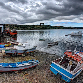 Low Tide in Castro by Charles Brooks - Transportation Boats ( water, reflection, palafitos, hdr, boats, sea, house, beach, sky, graduated, ripples, nd, cloud, dinghy )