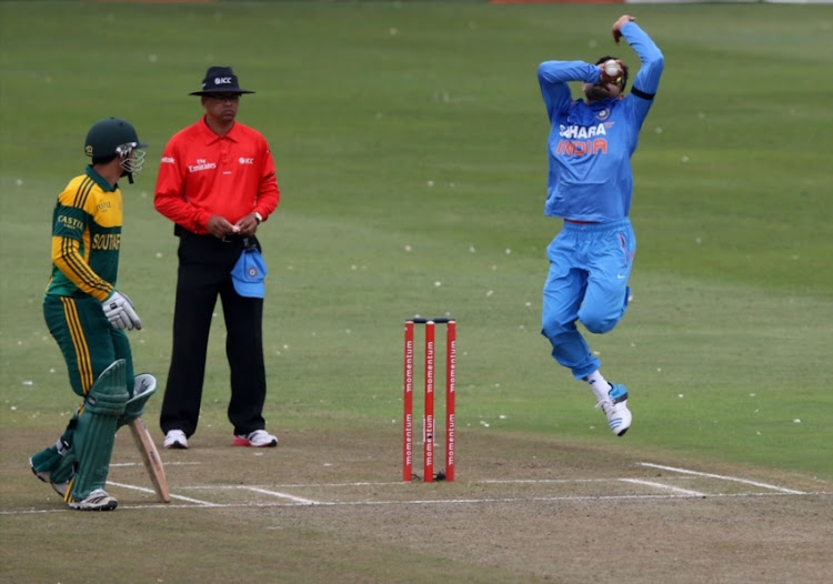 Virat Kohli of India bowls during the 2nd Momentum ODI match between South Africa and India at Sahara Stadium Kingsmead on December 08, 2013 in Durban.