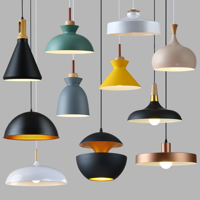 This photo shows an array of ceiling lamp shades in different shapes and colours such as black, blue. yellow, cream and rose gold.