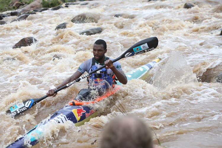 Sbonelo Khwela navigating through at Mission Rapids on Day 1 of the Dusi Canoe Marathon. He came in first place.