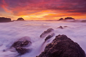 Photo: Slow Burn  This image was shot a couple days ago at one of my favorite places - Sutro Baths. It takes me about 20 minutes to get there, so if conditions look promising from my home, I will try to get there for sunset. In this instance, I went at least an hour early so that I could just sit down on the rocks and get in tune with the place.   The cadence of the waves and the vibrations they throw off when slamming into the rocks... the different patterns of silence as the ocean pulls back before a large breaker ... the way the spray swirls around the eddies in the wind currents ... I love it all!  Only after sitting for a long while did I pick my location and begin to shoot. It felt very trance-like as I danced up and down in the rocks. Every time I needed to pick up my gear and move up out of the way then back down into a hole for another shot ... it was done without thinking, just moving with the cadence of the ocean. I know sounds weird, but it really is all just a daze :) ~joe  Tech: 17mm, f/13, 1 second, ISO 100