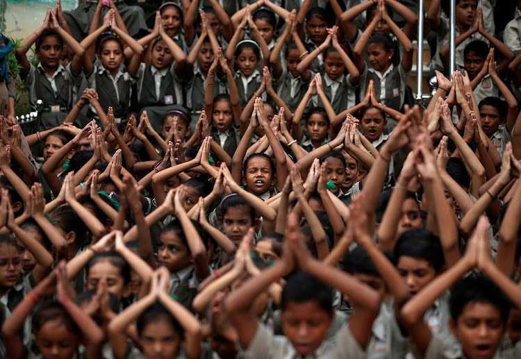 School pupils pray for rain at a temple in Ahmedabad, India.