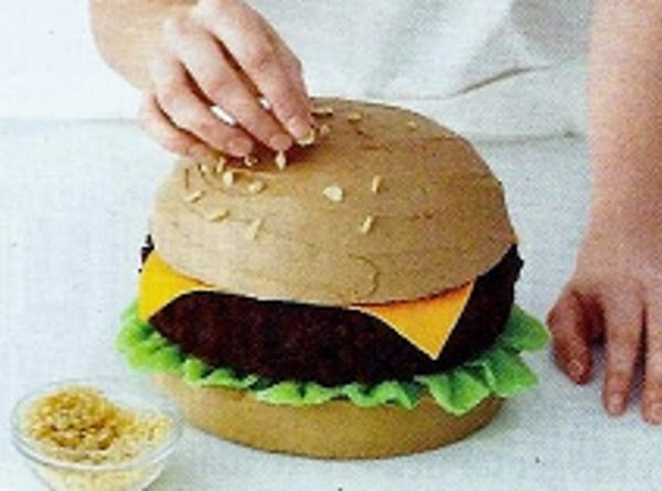Assemble the burger: Put the chocolate patty on the bottom bun, then drape the...