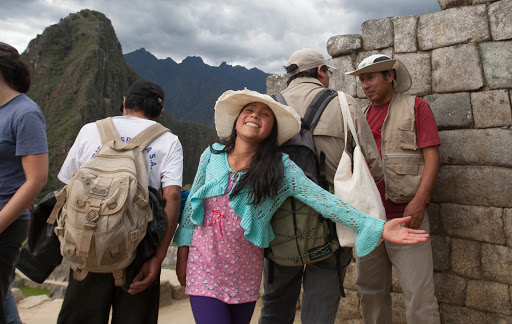 A Peruvian girl greets visitors at Machu Picchu, Peru.