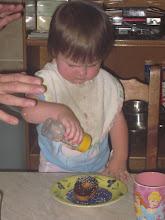 Photo: Applying sprinkles to her donut