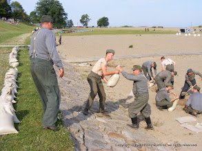 Photo: Sandbagging – top Tim Jones, Chester, Ill., Tim Schulte, St. Paul, Mo.
